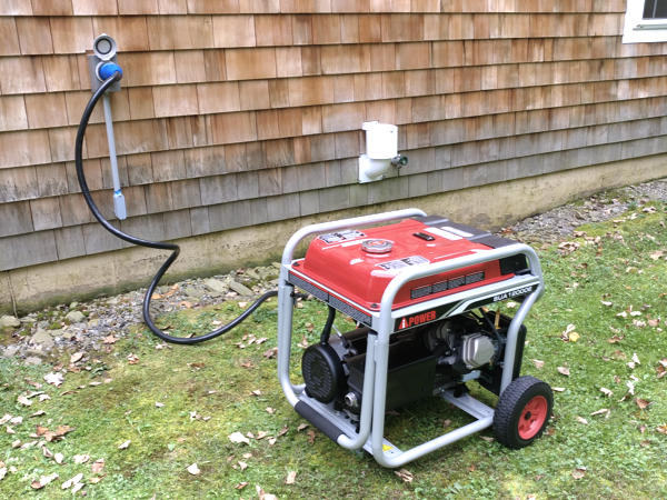 portable generator outside and connected to a house with a cable